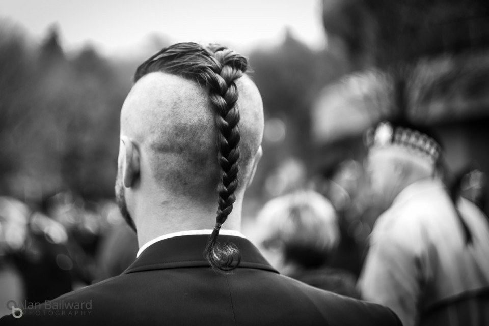 Spectator with amazing hair watching the Remembrance Day Parade